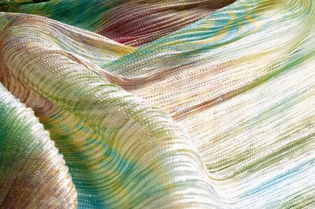 Pleated fabric with colorful abstract drawings. Full frame take of a pleated fabric with a casual, hippie like pattern Stock Photo