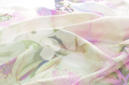 tapestry: Fabric silk pale pink with white flowers.  Flower Fabric background,  Fragment of colorful retro tapestry textile pattern with floral ornament useful as background