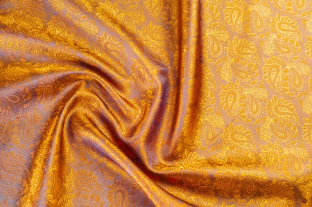 lining fabric: Silk. Lining brown. Closeup of lines in brown silk fabric. Brown background with shadows and smooth lines. brown background of shiny satin or silk folds