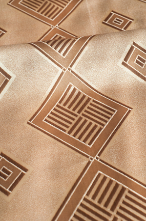 gold flax: Beige silk fabric texture with diamond pattern. The background - the checked paper