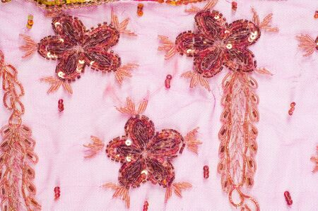 bead embroidery: Lace pink embroidered with beads and sequins