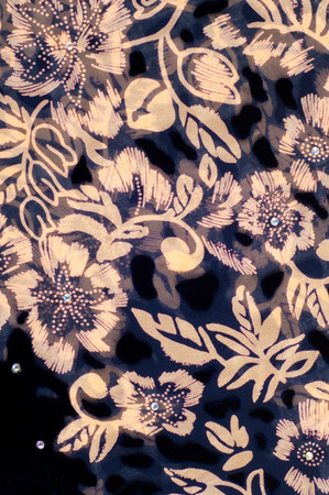 silk cloth: texture silk cloth. dark blue with goldpainted flowers Stock Photo