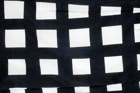 lining fabric: Batiste fabric texture. Checkered black and white dice