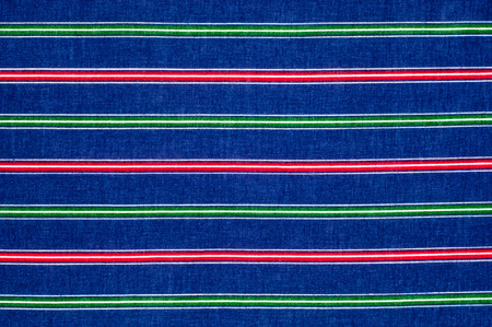 lining fabric: Batiste fabric texture. striped coloring, red green blue white stripes