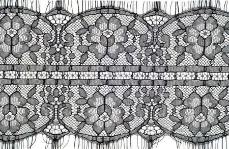 twisting: The texture of fabric lace.  Texture lace fabric. lace on white studio. thin fabric made of yarn or thread. typically one of cotton or silk, made by looping, twisting, or knitting thread in patterns Stock Photo