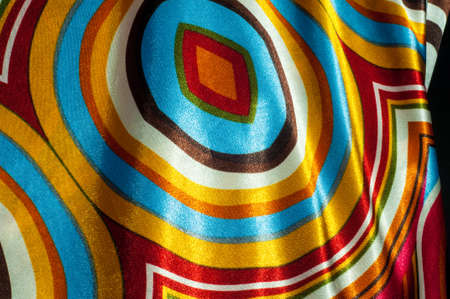 green brown: Silk fabric texture, abstract pattern, red yellow green brown white stripes, circles, ellipses squares shapes Stock Photo