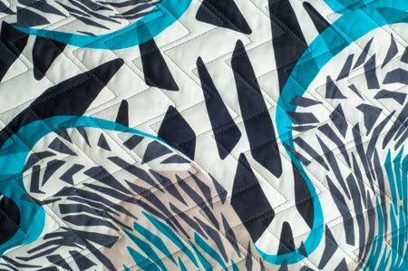 Insulated synthetic fabric with a pattern
