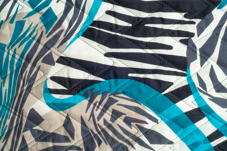 styrene: Insulated synthetic fabric with a pattern