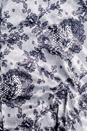 needle lace: Texture lace fabric. lace on white  studio. thin fabric made of yarn or thread. typically one of cotton or silk, made by looping, twisting, or knitting thread in patterns