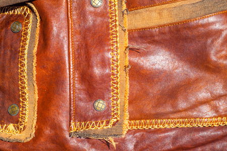 Leather Jacket texture, background with decorative stripes. an outer garment extending either to the waist or the hips, photo