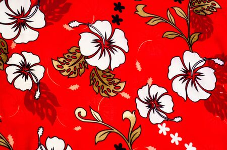 surrounds: Cotton fabric texture, background, painted white flowers on a red background. a soft white fibrous substance that surrounds the seeds of a tropical and subtropical plant
