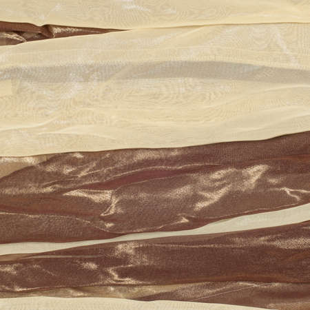 silk fabric: Silk fabric texture, background. Brown and cream stripes Stock Photo