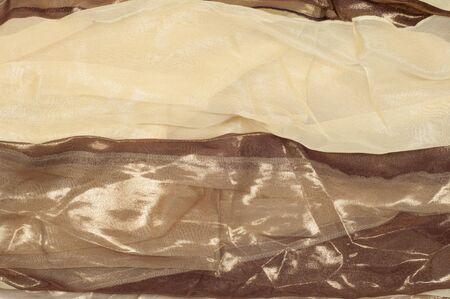 thai silk: Silk fabric texture background. Brown and cream stripes
