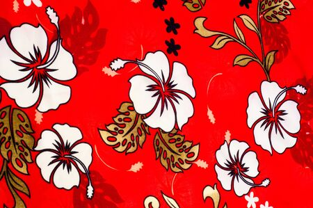 surrounds: Cotton fabric texture background painted white flowers on a red background. a soft white fibrous substance that surrounds the seeds of a tropical and subtropical plant