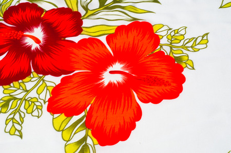 fibrous: Cotton fabric texture background painted red flowers on a white background. a soft white fibrous substance that surrounds the seeds of a tropical and subtropical plant Stock Photo
