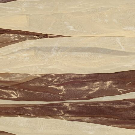 silk fabric: Silk fabric texture background. Brown and cream stripes
