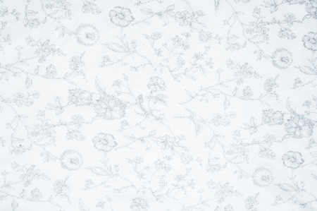 surrounds: Cotton fabric texture background white with painted flowers. a soft white fibrous substance that surrounds the seeds of a tropical and subtropical plant