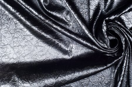 lame: Fabric texture silk black. With gray spots. abstraction
