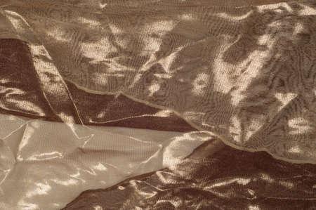 thai silk: Silk fabric texture, background. Brown and cream stripes Stock Photo