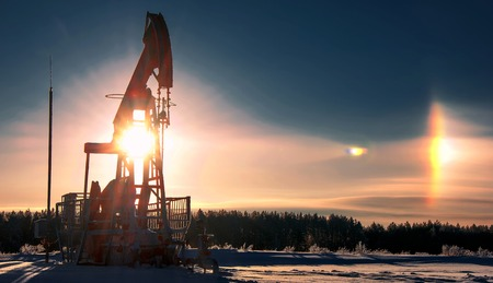 chink: rocking oil. Oil pumps. Oil industry equipment. wheat field Stock Photo