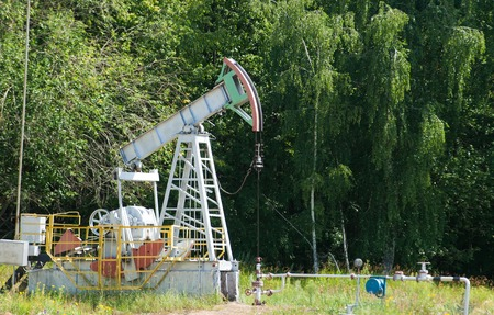 chink: Oil pumps. Oil industry equipment. Oil pump jack rocking. Rocking oil, Frosty Morning. Oil pumps. Oil industry Stock Photo
