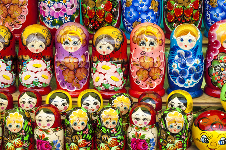 matryoshkas: Colorful Russian nesting dolls at the market. These matryoshkas are a very popular souvenir among tourists. different in pattern and color matryoshka