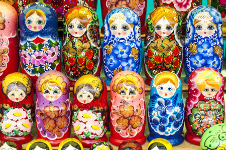 Colorful Russian nesting dolls at the market. These matryoshkas are a very popular souvenir among tourists. different in pattern and color matryoshka