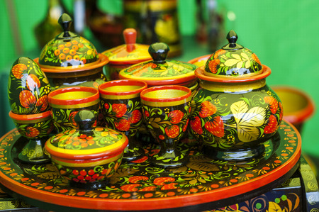 art and craft: khokhloma. Folk art craft painted wood; articles themselves painted in this way.