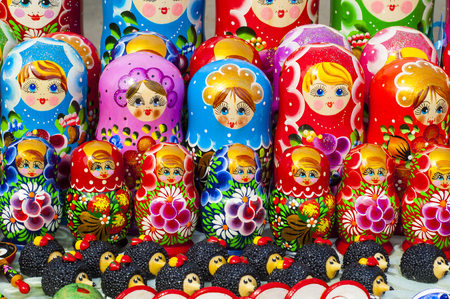 russian nesting dolls: Colorful Russian nesting dolls at the market. These matryoshkas are a very popular souvenir among tourists. different in pattern and color matryoshka