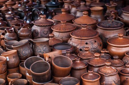 stoneware: pottery, earthenware, clayware, crockery, stoneware. a large container, typically earthenware,  with a handle and a lip, used for holding and pouring liquids.