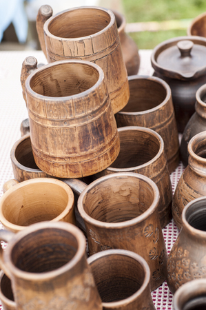 watertight: pottery, earthenware, clayware, crockery, stoneware. a large container, typically earthenware,  with a handle and a lip, used for holding and pouring liquids.