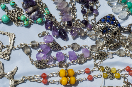 beading: bead, chaplet, beading. a small piece of glass, stone, or similar material, typically rounded and perforated for threading with others as a necklace Stock Photo
