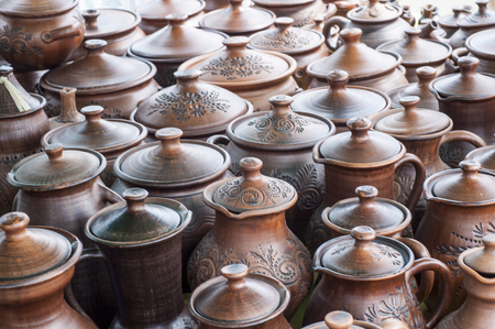 ewer: pottery, earthenware, clayware, crockery, stoneware. a large container, typically earthenware,  with a handle and a lip, used for holding and pouring liquids.