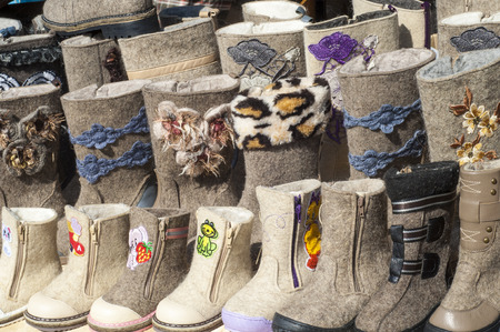 rubber sole: felt boots. Valenki. Stock Photo
