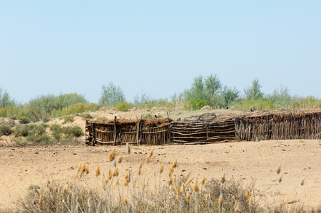 wilds: desert, wilderness, sands, wilds, waste, sahara. a pen for livestock, especially cattle or horses, on a farm or ranch. a fertile spot in a desert where water is found. Stock Photo
