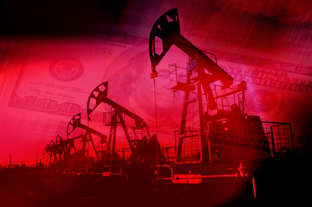 Oil pump on background of US dollar. Oil and gas industry. Work of oil pump jack on a oil field. White clouds and blue sky. oil well pump. Oil and gas industry.
