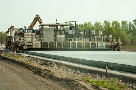 paver: Almaty region, Kazakhstan, 18. 12. 2014. Texture curing machine TCM 1800 Wirtgen. concrete paver Editorial