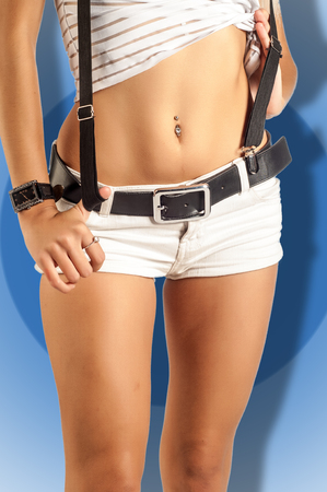 belly button: Closeup of a belly button that is pierced with jewelry in it Stock Photo