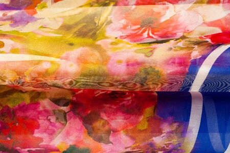 bstract: Fabric silk texture. abstract painting. bstract wave pattern on silk batik. a fine, strong, soft, lustrous fiber produced by silkworms in making cocoons and collected to make thread