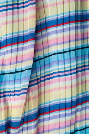 plisse: Pleated fabric. Sinii yellow red white stripes texture. Photography Studio