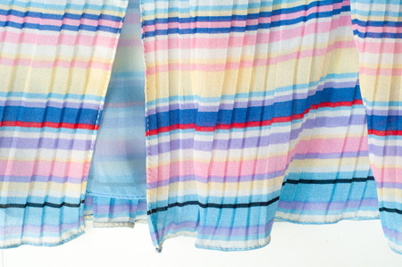 pleated: Pleated fabric. Sinii yellow red white stripes texture. Photography Studio