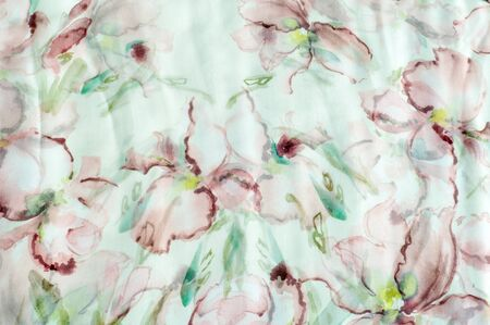 an inflorescence: Fabric silk texture, abstract flowers drawn on the fabric