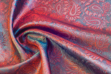 thai painting: fabric texture red brown, terracotta. Painting on silk cloth. Thai painting pattern of golden brown silk cloth full frame. Stock Photo