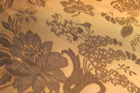 wild silky white: Fabric silk texture color Sandy Brown. With woven into the fabric flowers