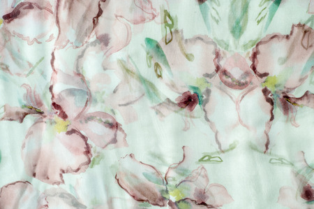 Fabric silk texture, abstract flowers drawn on the fabric