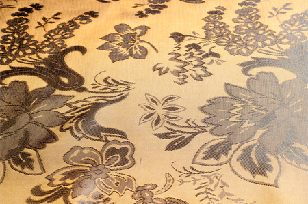 sandy brown: Fabric silk texture color Sandy Brown. With woven into the fabric flowers