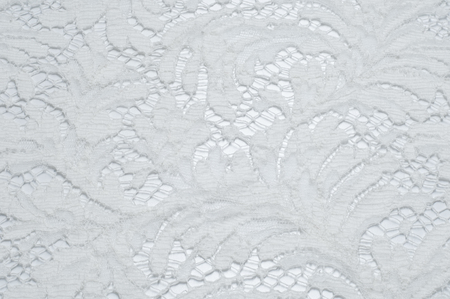 needle lace: Texture lace fabric. lace on white background studio. thin fabric made of yarn or thread. typically one of cotton or silk, made by looping, twisting, or knitting thread in patterns