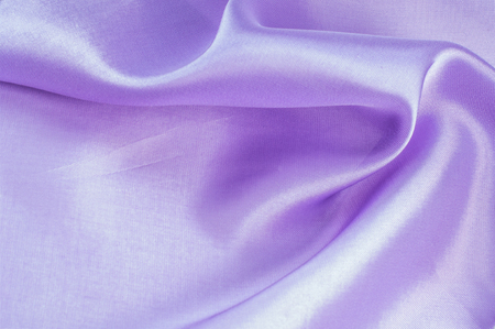 furl: Lining texture, satin, lilac. Abstract image of purple paper rolls