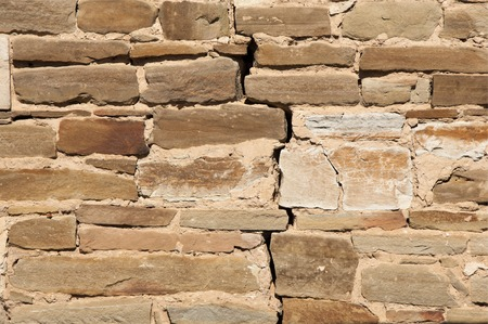 stratified: Texture. Wall lined with stone wild.  Wild sandstone