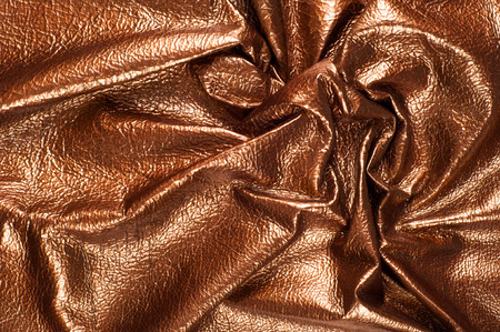 color skin brown: The texture of the skin color. Skin texture, background Golden brown shiny skin Stock Photo